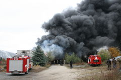 Fire department in action during burning warehouses with plastic products. KHMELNITSKY, UKRAINE - OCTOBER 11: fire department in action during burning warehouses stock photography