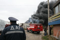 Fire department in action during burning warehouses with plastic products Royalty Free Stock Photo