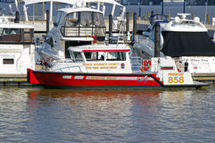 Fire Department Boat Docked in National Harbor. In fire and rescue boat work, the emphasis is usually on the rescue part. More than 90% of calls are to get Royalty Free Stock Photos