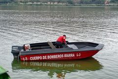 Fire department boat. In Lago Yahuarcocha in Ibarra, Ecuador royalty free stock photography