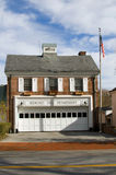 Fire department building Bedford New York. Brick fire department buidling in Bedford Village New York with flag Royalty Free Stock Image