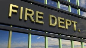 Fire Department building sign closeup, with sky. Reflecting in the glass Stock Photo