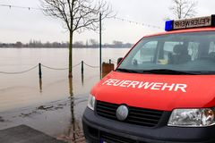 Fire department car on the flooded shore of a river.  stock images