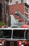 Fire Department of the City of New York FDNY. NEW YORK, USA - May 02, 2016: Firefighters of New York City after the fire suppression of Manhattans Serbian royalty free stock photo