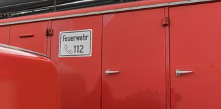 Fire Department. Detail of a fire truck with german text: Fire Department 112 Stock Photo