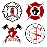 Fire department emblems and badges. Set of fire department emblems and badges Royalty Free Stock Photos