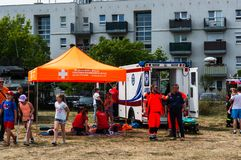 Fire department event. Poznan, Poland - June 9, 2018: Ambulance workers giving first aid instructions during the Bezpieczne Wakacje event on the local fire royalty free stock images