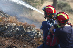 Fire Department Extinguishes a forest fire. THESSALONIKI, GREECE - AUGUST 26: Fire Department Extinguishes a forest fire in Seich Sou on August 26, 2011 in stock image