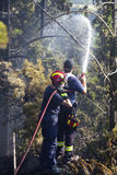Fire Department Extinguishes a forest fire. THESSALONIKI, GREECE - AUGUST 26: Fire Department Extinguishes a forest fire in Seich Sou on August 26, 2011 in stock photography