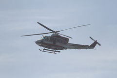 The fire department helicopter flies over the sea Stock Images