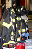 Fire department. Inside an American Fire Station showing jacket and helmets royalty free stock images