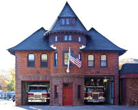 Fire Department in Montclair NJ. Historic two-story red brick building with two open gates that are fire trucks royalty free stock photo