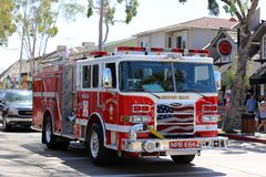 Fire department in Newport Beach. Fire department truck driving in Newport Beach and showing great shining royalty free stock photos