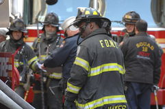 Fire Department NYC in Action. The men in the fire department in action on a rescue mission royalty free stock images