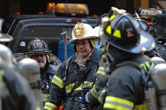Fire Department NYC in Action. The men in the fire department in action on a rescue mission royalty free stock image