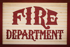 Fire department. Old fire department sign painted on wood royalty free stock photo