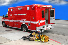 Fire department paramedic. Fire department truck and used fireman's uniform Royalty Free Stock Image