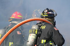Fire department. A picture of a fire being put out stock images