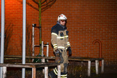 Fire department putting out arson. Swedish fire department putting out fire right next to a school in poorest parts of Malmo city. Arson is now a daily Royalty Free Stock Photos
