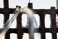 Fire department putting out a fire in a building. Fire department putting out a fire in an historic textile mill in Bibb City Georgia royalty free stock photography