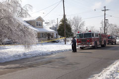 Fire department response to ice storm. LOUISVILLE - 31 JANUARY: Engine 18 firemen discuss a downed residential power line while waiting for electric crews to royalty free stock photos