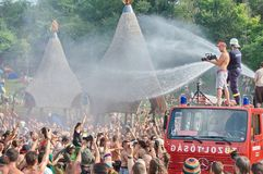 Fire department spray water on crowd Royalty Free Stock Photo