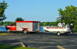 Fire Department Water Rescue Unit. A Berlin Township fire department vehicle towing a water rescue boat while leaving the scene of a tragedy at an Ohio State stock images