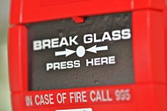 Fire alarm. Close-up photo of a Fire alarm activation unit - break glass stock image