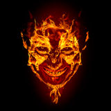 Fire devil face. On black background Stock Image