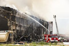 Large fire disaster in a warehouse Stock Images