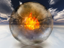 Fire in diviners sphere. In surreal landscape Stock Photos