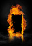 Fire door. Burning frame where you can insert any object (door, smartphone, tablet, book, etc Stock Image