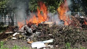 Fire at the dump in, Illegal burning of waste in violation of environmental norms. Burning fire in waste incineration stock footage