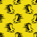 Fire eagle on a yellow background. Royalty Free Stock Photo