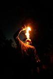 Fire-eater. Young man - fire-eater in the dark forest Royalty Free Stock Image