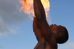 Fire Eater at the Circus. Circus fire-eater blowing a large flame from his mouth Stock Images