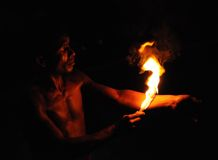 Fire eater from Kandy town. In Ceylon believe, subordinating the element of fire, the man and tames the forces of evil. Royalty Free Stock Image