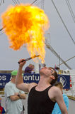 Fire Eater. Male Fire Eater performs for the public at an event in Blyth, Northumberland, England, UK Stock Photo
