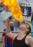 Fire Eater. Male Fire Eater performs for the public at an event in Blyth, Northumberland, England, UK Royalty Free Stock Image