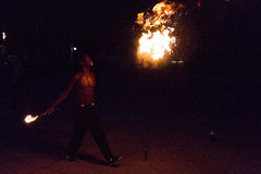 Fire-eater performance on a street Stock Images