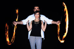 Fire-eater spinning fire Stock Images