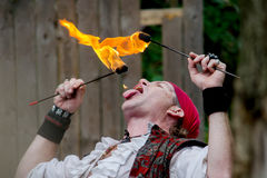 Fire eating pirate Stock Images