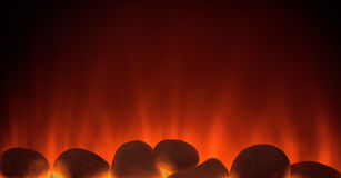 Fire electric fireplace with pebbles Royalty Free Stock Photos
