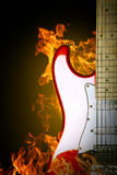 Fire electric guitar. Music instrument on dark background Royalty Free Stock Photo