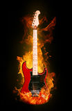 Fire electric guitar. Music instrument on dark background Royalty Free Stock Images