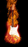 Fire electric guitar. Burning electric guitar isolated on black background Stock Photo
