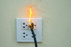 On fire electric wire plug Receptacle and adapter on white background. Electric short circuit failure resulting in electricity wire burnt royalty free stock photos