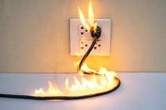 On fire electric wire plug Receptacle wall partition stock photography