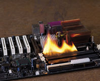 Fire on electronic board Stock Images
