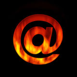 Fire email symbol. Isolated on dark background Royalty Free Stock Photography